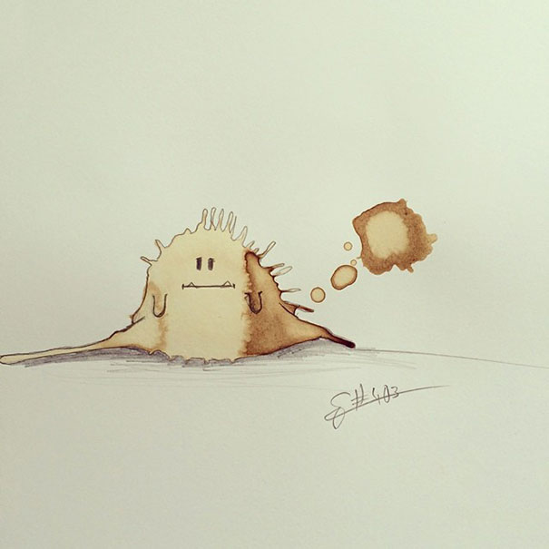Cute monster drawing made from coffe stains