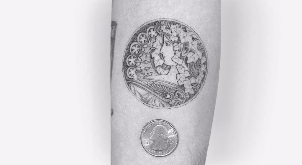 Alphonse Mucha adaptation tattoo by Daniel Winter 1024x560 9 Awesome Minimalist Tattoos Ideas
