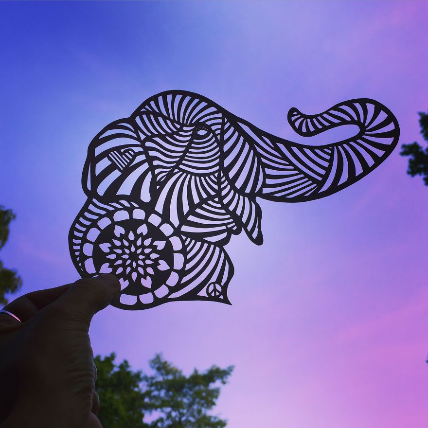 Elephant paper cut art by Jo Chorny Gorgeous Paper Cut Outs And Contrasts Them With The Sky Background