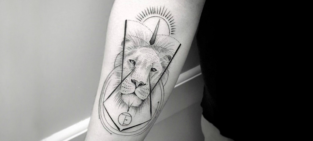 Lion tattoo by Balasz Bercsenyi 1024x462 9 Awesome Minimalist Tattoos Ideas