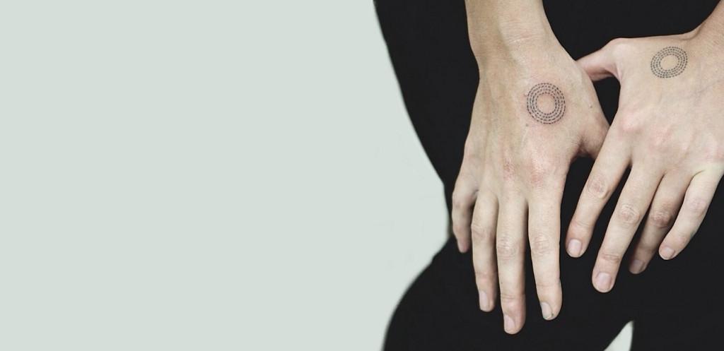 Minimal tree ring tattoos by Stanislava Pinchuk 1024x497 9 Awesome Minimalist Tattoos Ideas