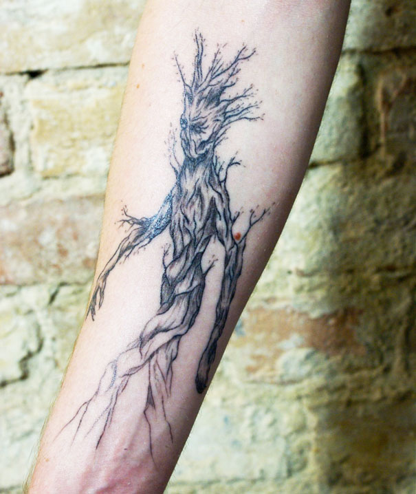 linear animal tattoo 4 Beautiful Tattoos Design That Flowing Naturally In the Body