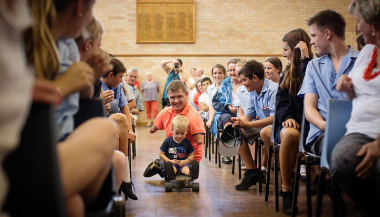 Chris Koch entertaining the students at Coonabarabran High School Australia Photographers Capturing Inspiring Journey of a Man Without Arms and Legs