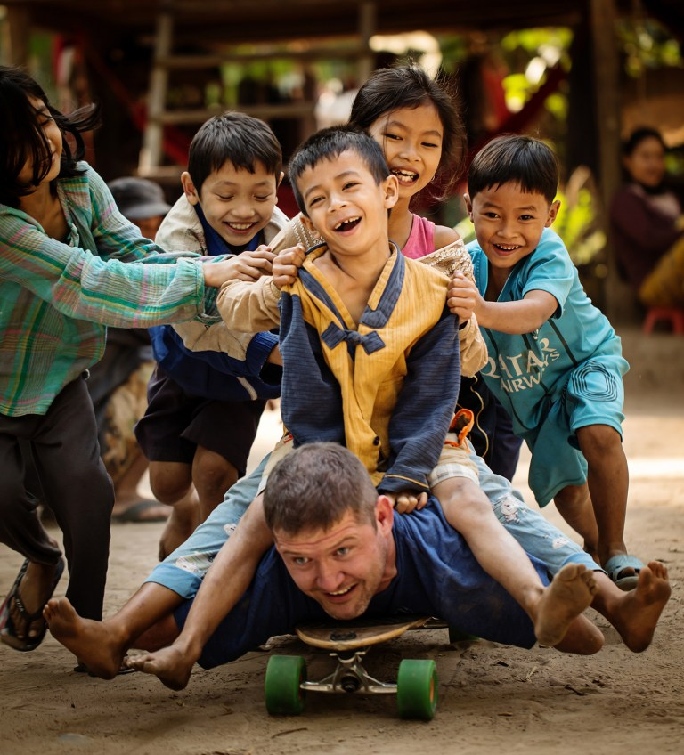 Entertaining kids Siem Reap Cambodia Photographers Capturing Inspiring Journey of a Man Without Arms and Legs