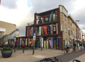 Creative Street Art Illusion Giant Bookcase On An Apartment Building